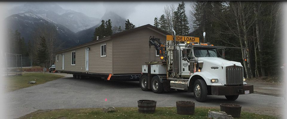 Truck moving modular home