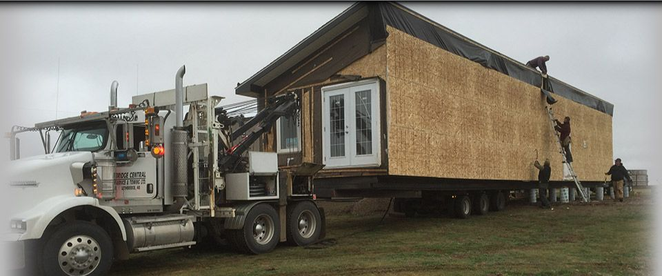 Truck towing modular home